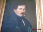 Dieses Ölbild und das Porträt oben links könnten Selbstporträts sein. Doch beide Männer haben unterschiedliche Augenfarben, sodass es sich vermutlich nicht um dieselbe Person handelt.